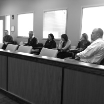 DCS family case managers and Local Office Director Rico Rosado (far right) listen to opening instructions before the mock trial begins. Case managers (from left to right): Sam Charbonneau, George Shaheen, Laura Elliott, Kristen Wilcken and Lana Tucker.