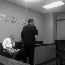 DCS Local Office Director Rico Rosado observes the proceedings as Chief Deputy Prosecutor Steven Owen cross-examines a witness.